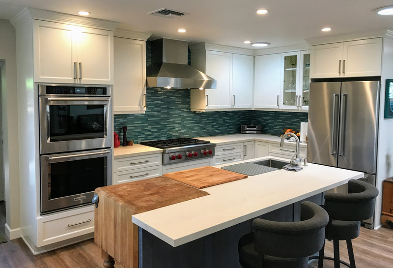 Cabinets by Shamrock in Shaker.  Island by Dewils.  Kitchen by Woodcrafters International Inc.